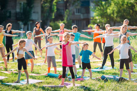 Yoga classes outside on the open air. Kids Yoga,