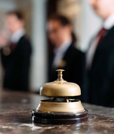 Hotel service bell Concept hotel, travel, room,Modern luxury hotel reception counter desk on background.