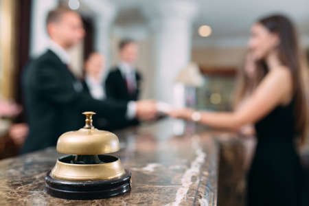 Picture of guests getting key card in hotel. Banque d'images