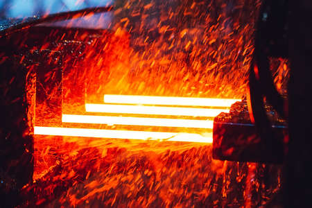 hot steel on conveyor in steel mill, metallurgical products.