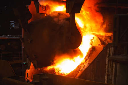 smelting of the metal in the foundry. Metallurgical products. Фото со стока