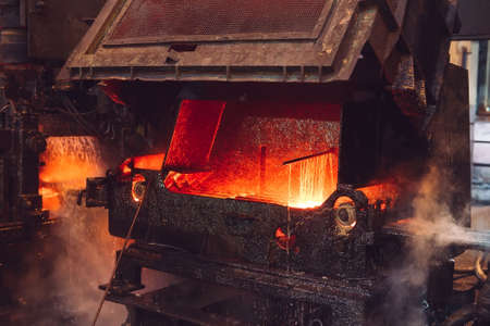 hot steel on conveyor in steel mill, metallurgical production or plant.
