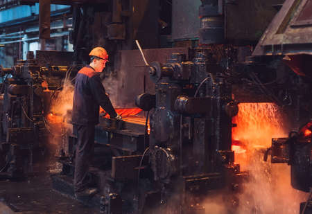 Workers in the steel mill. Metallurgical production or plant.