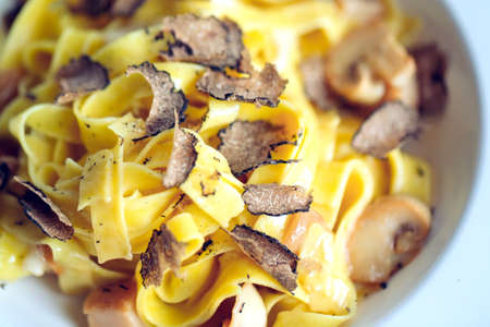 Pasta with truffles, typical autumn dish.Restaurant menu dish.