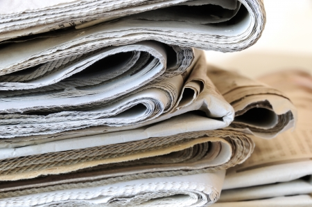 stack of folded newspapers Stock Photo