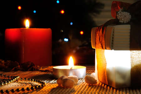 night Christmas gift with two candles Stock Photo