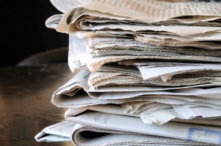 stack of newspapers on black table photo
