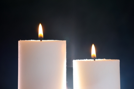 two candles lit and aura