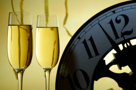 two glasses and a watch for the celebration of the new year Stock Photo