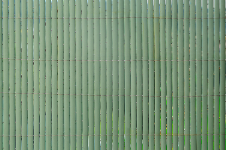 green synthetic hurdle fence covering