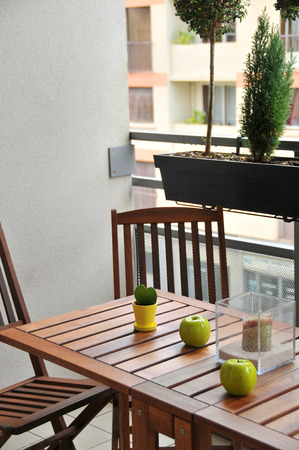 terrace with wooden table and two chairs and decor Stock Photo
