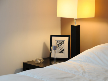 hotel room with table and lamp Stock Photo