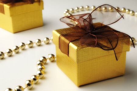 gifts and golden pearls with white background