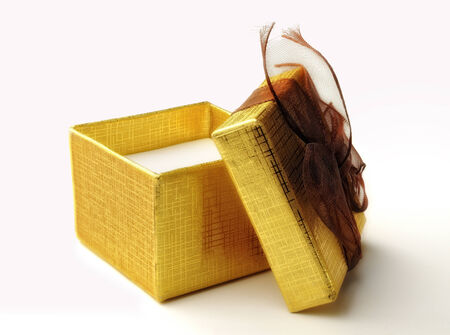 Open golden gift box isolated