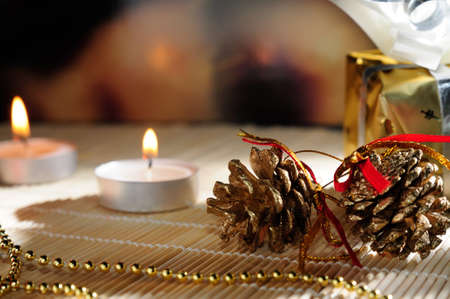 Christmas decoration with pinecone, candles