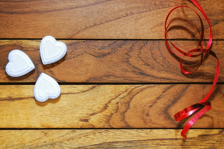 hearts forming a clover with wood and red ribbon