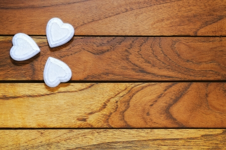 hearts forming a clover with wood