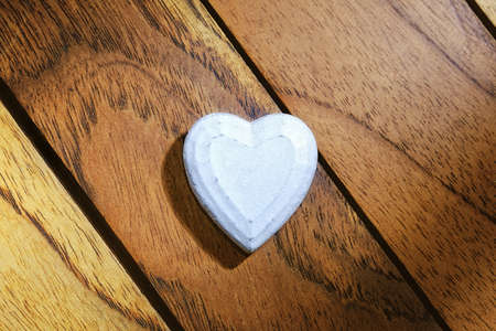 white heart with diagonal wood background