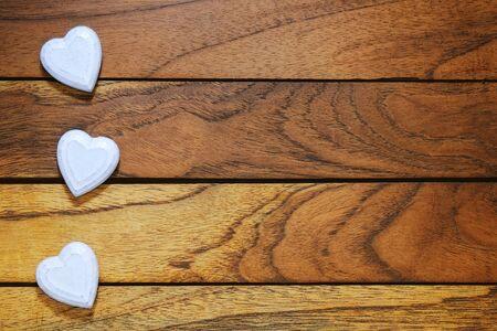 three white hearts misaligned with wood  Stock Photo