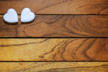 Two white hearts with wooden