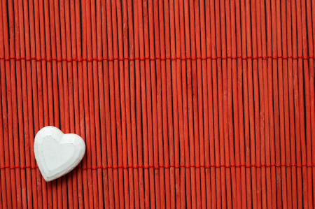 white heart on red bamboo bottom corner left Stock Photo