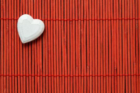 white heart on red bamboo top left corner Stock Photo