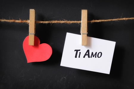 heart with ti amo poster hanging with blackboard background photo