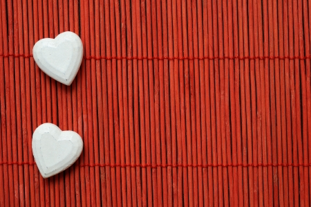 two white hearts on red bamboo lined