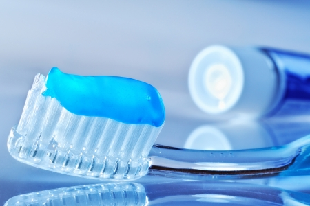 toothbrush on the table with toothpaste and toothpaste tube Archivio Fotografico
