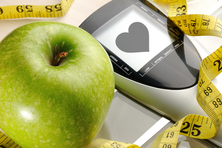 apple,measuring tape and scale for a healthy life photo