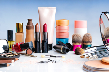 makeup set on glass table front view photo