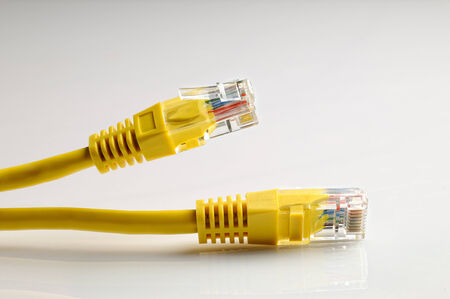 rj45: closeup of the yelow ethernet cables isolated