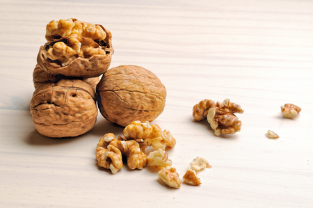 group of walnut on a white wooden table Stock Photo