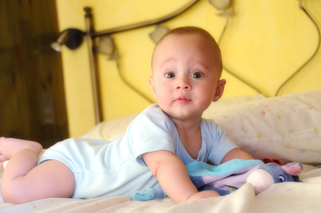 Built on the bed baby facing forward curiously Stock Photo