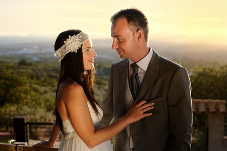 bride and groom eye contact at sunset at a viewpoint