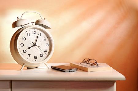 belongings: bedside alarm clock and personal belongings in the morning