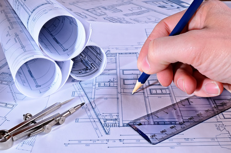 dwelling: a contractor pointing measurements in planes of a dwelling