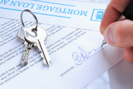 client signing the mortgage loan agreement upon delivery of the keys to a new home