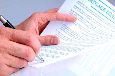 mortgage document: client signing the mortgage loan agreement for the purchase of a new home Stock Photo
