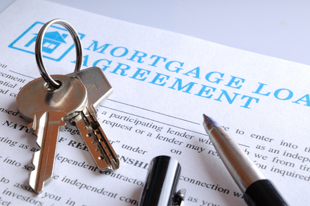 mortgage document: Receiving the keys and the mortgage contract for a new house to complete and sign