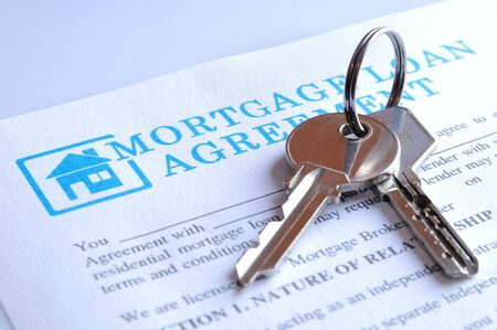 borrowed: Delivery of the mortgage contract for a new house and keys Stock Photo