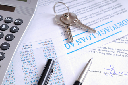 borrowed: Calculation of mortgage loan and signed agreement for the purchase of a new house top view Stock Photo