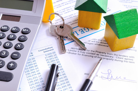 Calculation of mortgage loan and signed agreement for the purchase of a new house top view Stock Photo