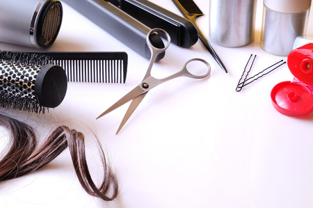 hair curler: Set hairdressing articles exposed on a white table with room below right to write