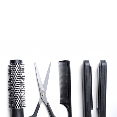 haircutting: hairdressing accessories set for cutting and styling hair isolated with white background down Stock Photo