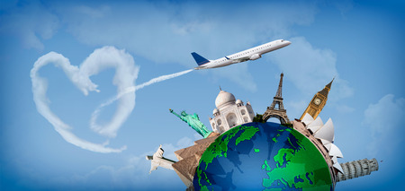 Concept of travel around the world with representation of the globe and monuments around. With heartshaped clouds photo