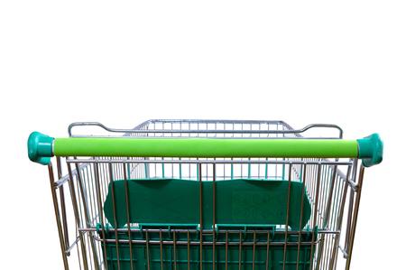 Empty shopping cart in the supermarket aisle. Rear view with perspective. horizontal composition Foto de archivo