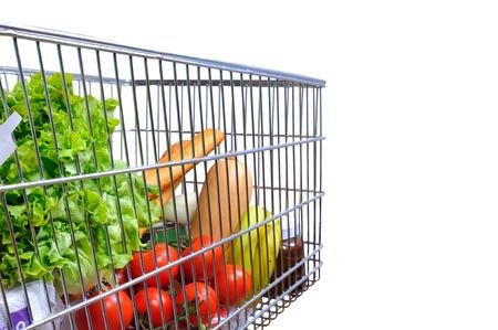 tilt view: Shopping cart full of food isolated white. Side tilt view. Horizontal composition
