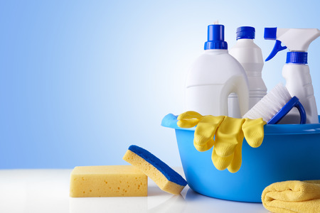 Professional cleaning equipment on white table and blue background overview. Cleaning tools company concept. Front view. Horizontal composition. Stock Photo