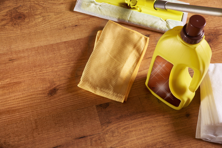 wooden floors: Tools and products for the maintenance of wooden floors. With brightening, rag, mop and chamois on wooden floor. Elevated top view. Horizontal composition. Stock Photo